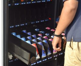local-snack-vending-machine-being-stocked-by-suppl-AX2THSV